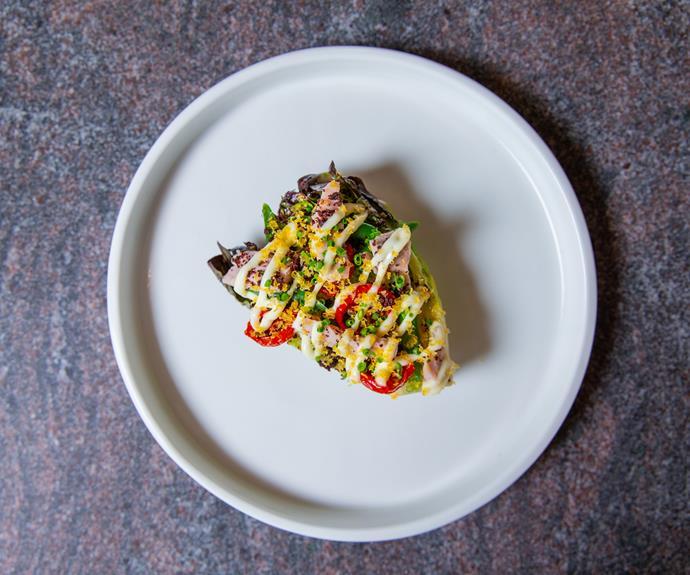 Tuna salad, green bean, tomato, egg yolk, black olive.