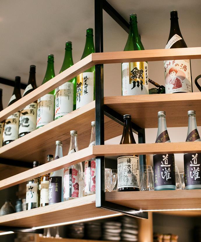 Organic Junmai sakes line the shelves at Sumi Open Kitchen.