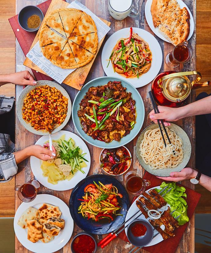 Dishes from Dolan Uyghur Restaurant, including lagman and kawap (bottom right).