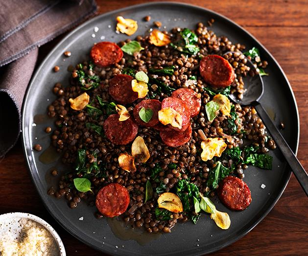 """**[Green lentils with salami and cavolo nero](https://www.gourmettraveller.com.au/recipes/browse-all/green-lentils-with-salami-and-cavolo-nero-12488 target=""""_blank"""")**"""