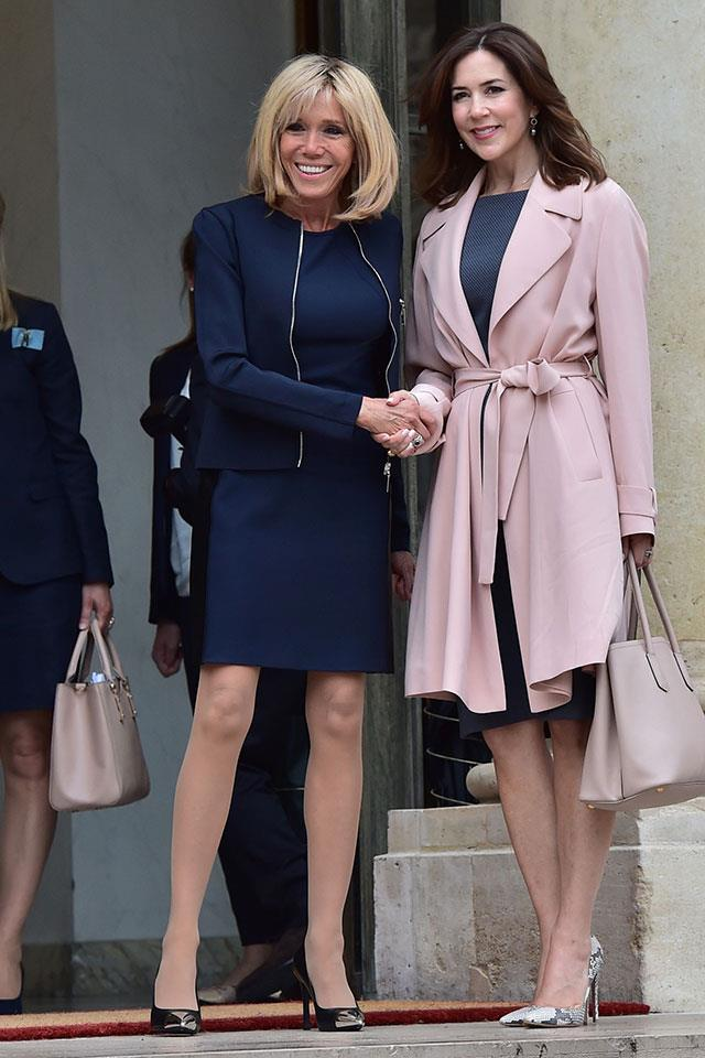 Macron, in Louis Vuitton, and Mary, Crown Princess of Denmark, had a chic political meet-up regarding climate change in Paris in June.