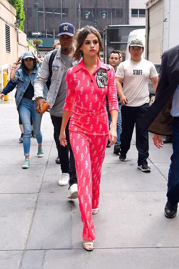 **June 5th, 2017**  Selena stepped out in her fourth outfit of the day, a hot pink polo jumpsuit with cat details by Miu Miu.