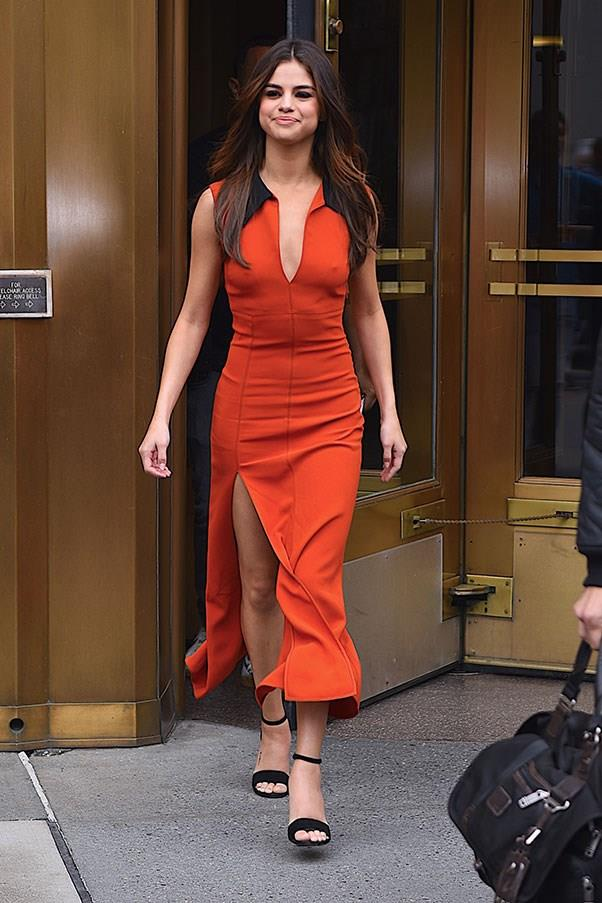 **June 5th, 2017**  Selena wore a low-cut rust coloured dress for her second outfit of the day.