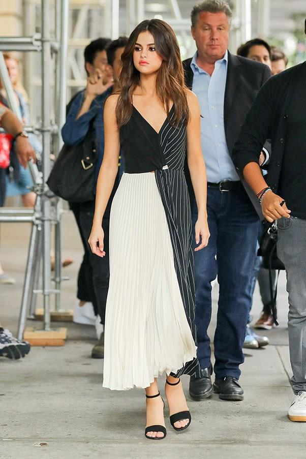 **June 5th, 2017**  Selena's fifth outfit of the day was a sophisticated pleated dress worn with Louis Vuitton heels.