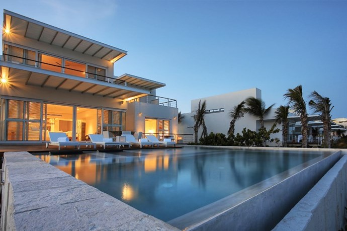 "**BLUE DIAMOND LUXURY BOUTIQUE HOTEL** <br><br> Playa del Carmen, Mexico, [slh.com](http://www.slh.com/hotels/blue-diamond-riviera-maya/|target=""_blank"") <br><br> Time to leave the kids at home—Blue Diamond is an adult-only spot. With two golf courses, three fine dining restaurants, a view of the crystal-blue Caribbean waters, and close proximity to Mayan ruins, this place is an adult luxury playground. Services across all rooms include meals, unlimited international calls, a snorkeling trip, and a Mayan Temazcal Session.  <br><br> *Prices starting at approx. $580 per night, per couple.*"