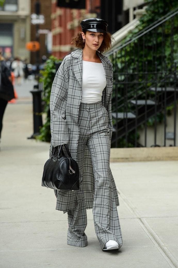 **Zimmermann** <br><br> Bella Hadid stepped out in New York City wearing a matching plaid [coat](https://www.modaoperandi.com/zimmermann-fw17/rife-wrap-trench-coat?mid=37385) and [trouser](https://www.modaoperandi.com/zimmermann-fw17/rife-flare-trouser?mid=37385) suit set by Zimmermann.