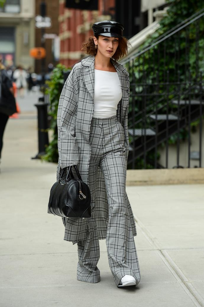 **Zimmermann** <br><br> Bella Hadid stepped out in New York City wearing a matching plaid [coat](https://www.modaoperandi.com/zimmermann-fw17/rife-wrap-trench-coat?mid=37385) and [trouser](https://www.modaoperandi.com/zimmermann-fw17/rife-flare-trouser?mid=37385) suit set by Zimmermann.