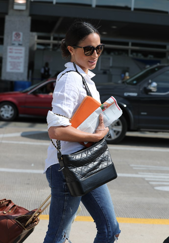 Meghan Markle arrives in Austin, Texas with a Chanel Gabrielle bag flung over her shoulder.