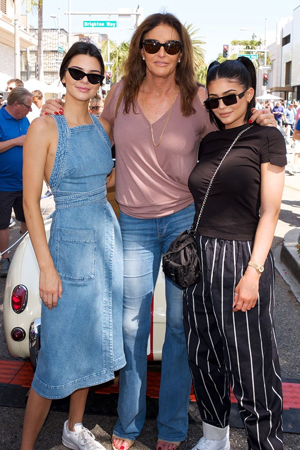 Kendall wore a denim dress, white Adidas sneakers and on-trend Matrix-style sunglasses while celebrating Father's day with sister Kylie Jenner and father Caitlyn Jenner.