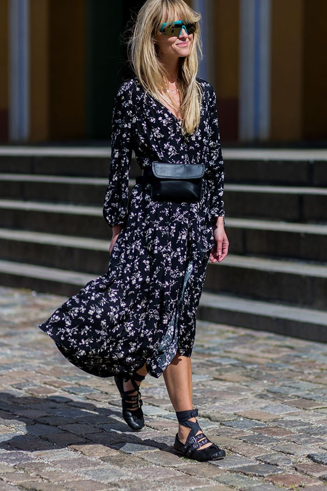 Apply a utilitarian edge to a pretty floral dress with a simple black beltbag.