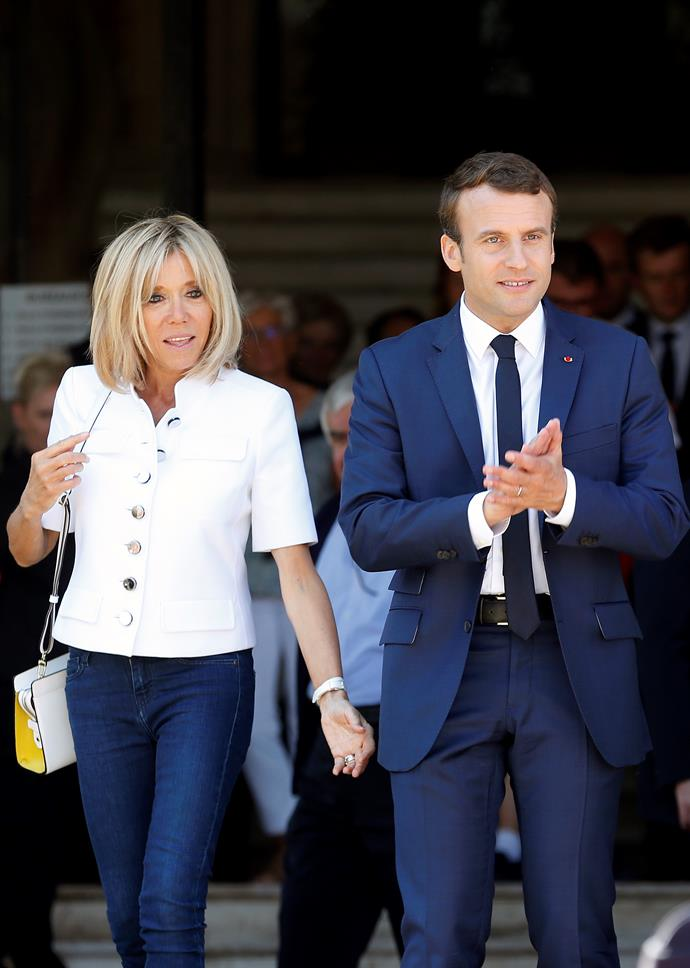 In a white button up shirt and blue jeans to vote in the French legislative elections with husband Emmanuel Macron.