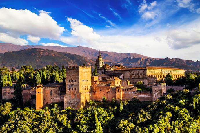 **8. Granada, Spain**  If Tapas is your thing, this city is for you. The jamón de trevelez (ham that is cured naturally) will become your food staple. As will the piononos (sweet pastries glazed with syrup and filled with cream).