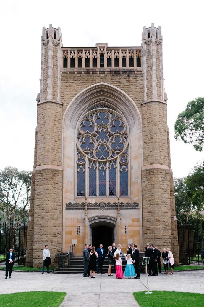 **On the location: ** The ceremony was at the Newman College Chapel of the Holy Spirit at University of Melbourne. Damian is Catholic, so it was very important that we were married in a formal Catholic service. I had seen other weddings that Erin and Tara had photographed at Newman College and it was love at first sight when we saw the Chapel for the first time. When you arrive at the Chapel its decorated gothic architecture and grandeur takes your breath away. The reception was at the Boatbuilder's Yard in South Wharf and overlooks the Yarra River. After the ceremony we wanted the reception itself to be a big party, where guests could let their hair down and celebrate with us! The reception venue was perfect for the 'Melbourne' vibe that we were going for, with beautiful 360 degree glass panels of the city at night. The space has black industrial beams and recycled hardwood furniture with lush greenery hanging from the ceilings. It fit our vision perfectly.