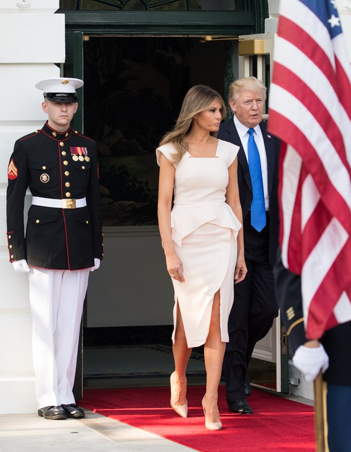 Trump opted for a structured knee-length cream dress to greet the South Korean president.