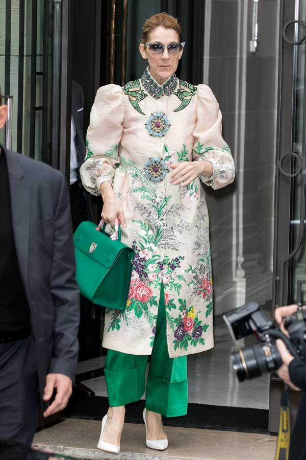 Céline stepped out in Paris wearing a botanical Gucci masterpiece, complete with matching emerald trousers and a piece Dior arm candy.