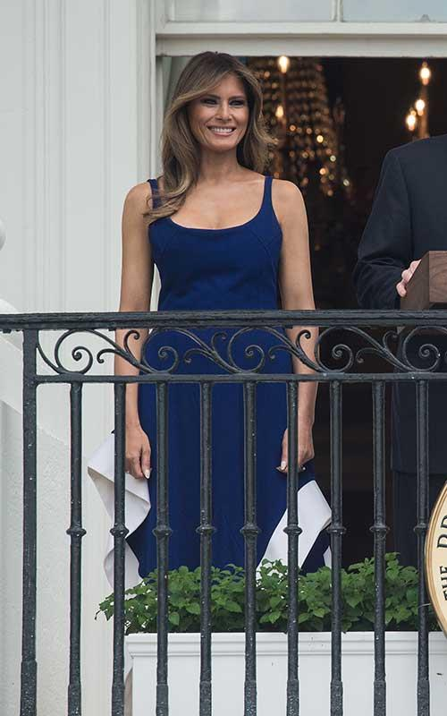 Melania Trump stepped out in a patriotic navy blue and white fit-and-flare dress by Esteban Cortázar for Independence Day.