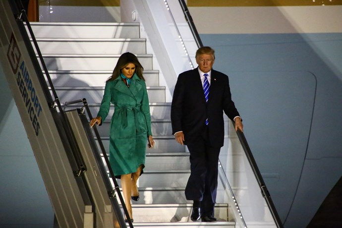 Trump arrived in Poland wearing an emerald green Diane von Furstenburg suede trench coat.