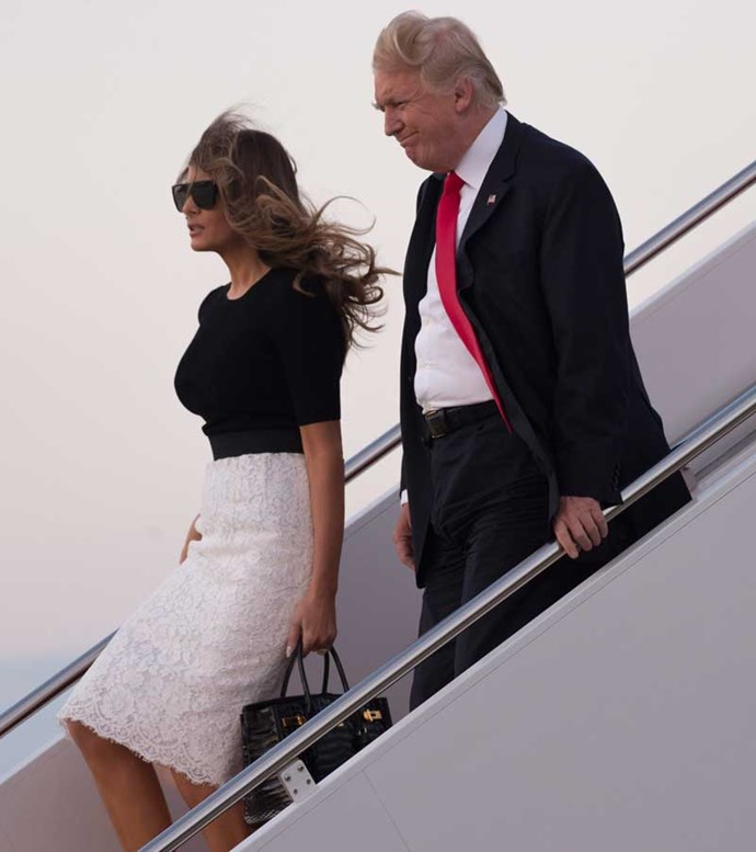 Melania touches down on US soil after the G20 Summit wearing monochrome Dolce & Gabbana co-ords and a shiny new Hermès Birkin bag.