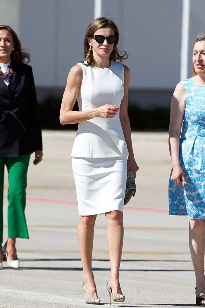 11th July, 2017 - Queen Letizia steps out on the tarmac to depart the UK wearing crisp white Hugo Boss co-ords with matching python accessories.