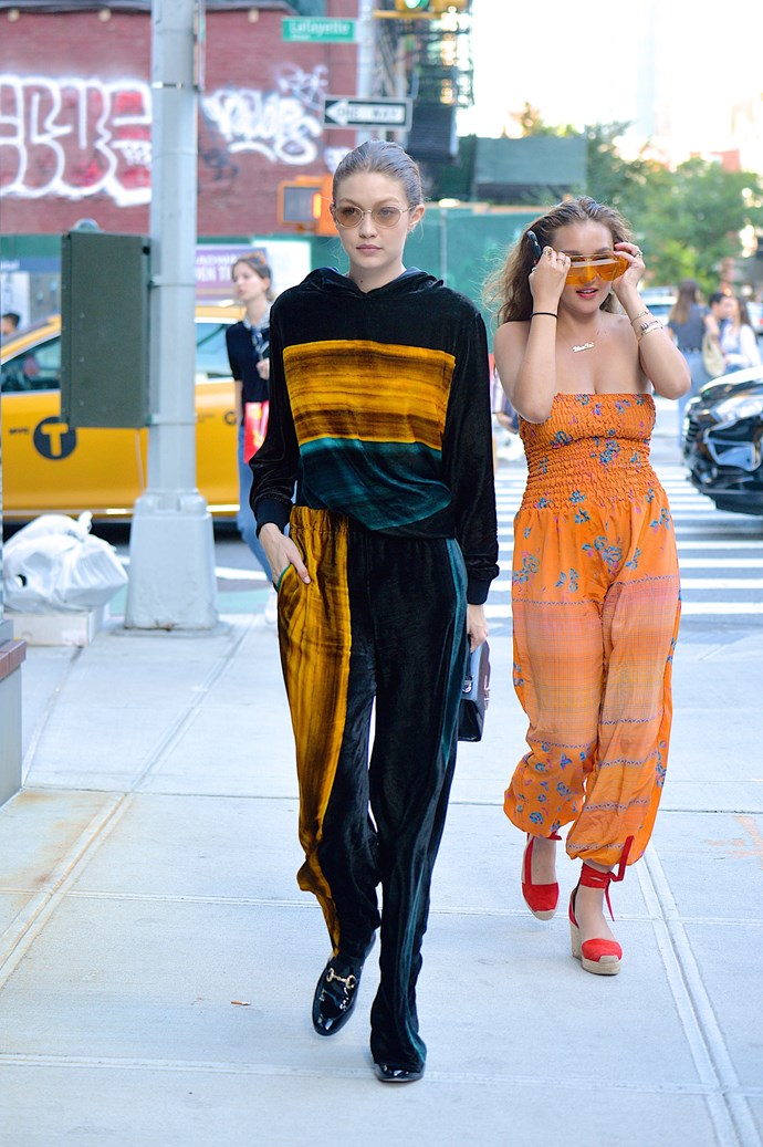 Gigi worked a striped velour jumpsuit, Andre Assous shoes and a STALVEY handbag while out in NYC.