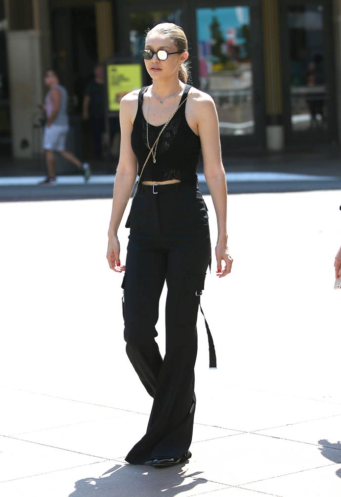 Gigi paired a mesh top with David Koma cargo pants and statement mirrored sunglasses on July 11 in New York.