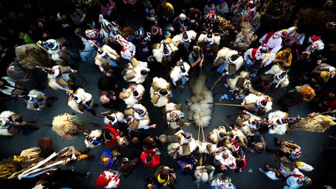 """**3RD PLACE, PEOPLE: """"LA VIJANERA"""" IN SPAIN BY JAVIER BUSTAMANTE**  """"La Vijanera is a winter carnival that takes place in the town of Silió, in Cantabria (Spain), the first Sunday of each year. This party consists of a group of hunters who want to capture a bear … This photo is the end of the party in which the bear is captured."""""""