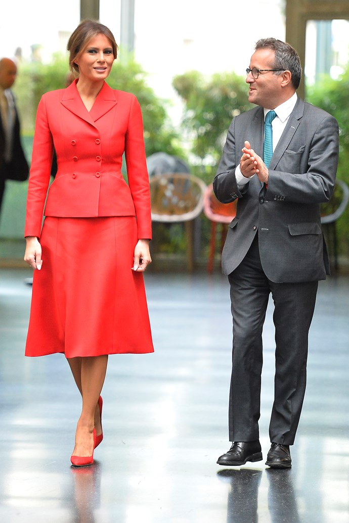 Melania Trump arrived in Paris wearing a red Dior skirt suit.