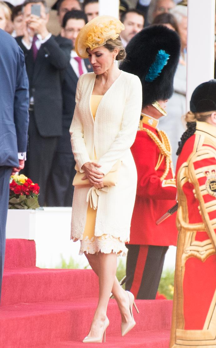 At her first state visit to London, wearing a canary yellow ensemble.