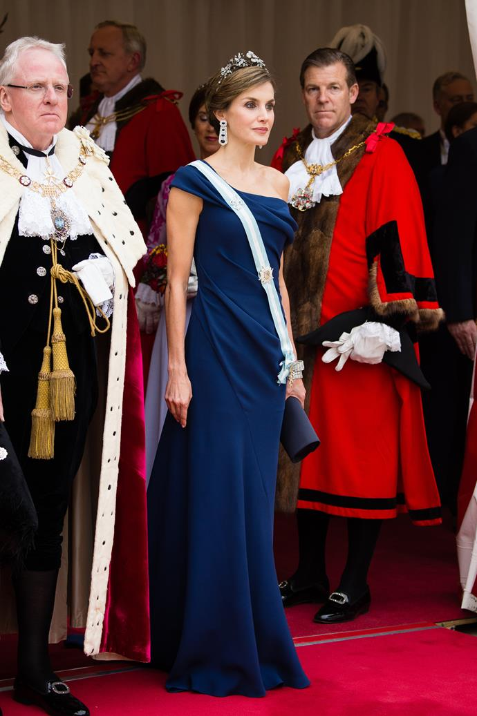 In a midnight blue gown and tiara at a banquet at Guildhall in London.