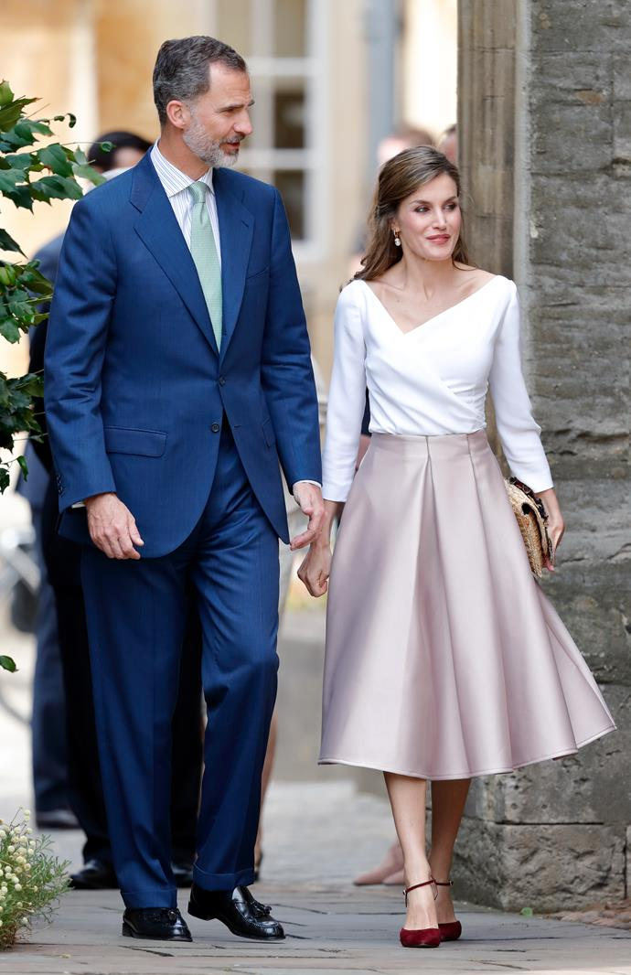 The Queen opted for a high street label while out in London, wearing a rose-hued full-skirt by Topshop.