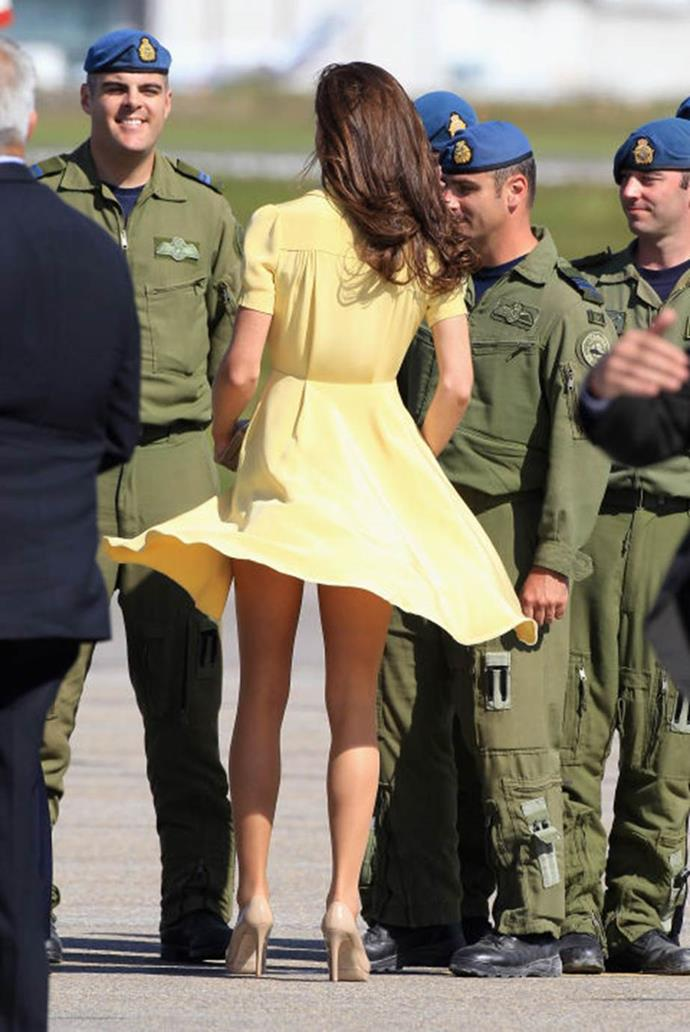**Playing peekaboo** <br><br> During the Cambridges' tour of Canada, Kate's floaty yellow dress got a little too floaty.