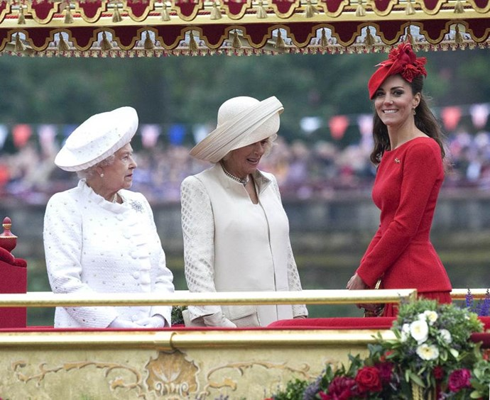 "**Standing out in red**<br><br>  At the Queen's Diamond Jubilee in 2012, Kate must have missed the memo from her in-laws to wear a neutral outfit. Calling her red suit ""striking as it was inappropriate,"" the *Daily Mail*'s headline for the event said: ""Did Kate really have to steal the show in her scarlet dress?"""