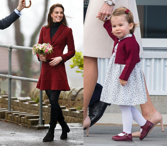 In opaque tights and rich burgundy outerwear.