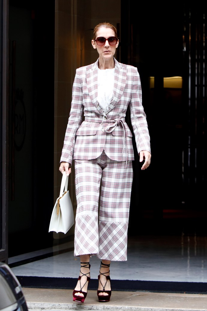 Céline stepped out in this Antonio Berardi plaid pantsuit, with velvet heels and a Céline handbag (no less).