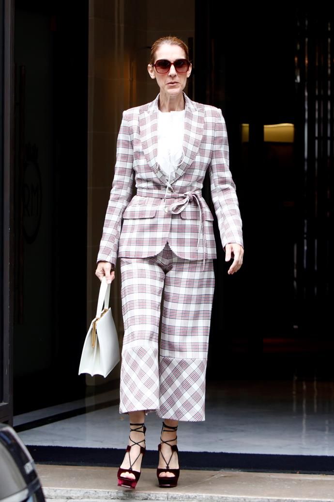 Céline stepped out in this Antonio Berardi plaid pantsuit, with velvet heels and a Céline handbag (no less).