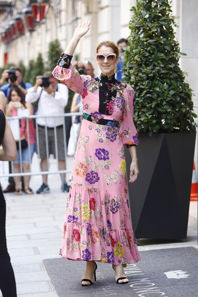 Céline stepped out in Paris wearing a pink floral Gucci dress and matching pink-accented shades.