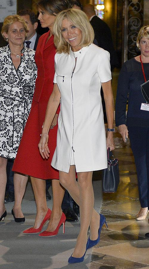 Wearing an understated ivory zip dress with Melania Trump while visiting Notre Dame Cathedral.