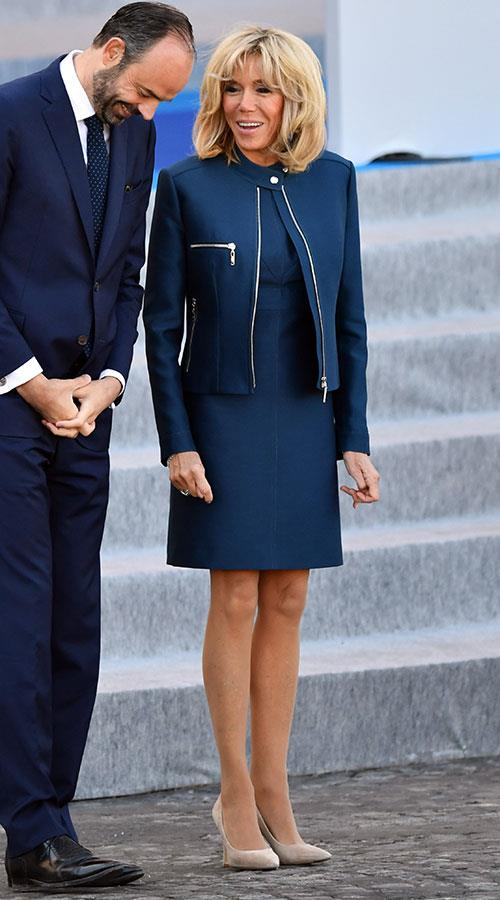 In an understated navy set she wore to meet Princess Mary a few week earlier, this time complete with a fresh neutral pair of pumps.
