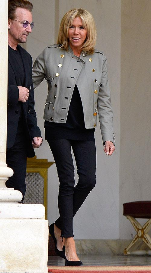 Wearing a statement utilitarian jacket as she leaves Elysee Palace alongside Bono.