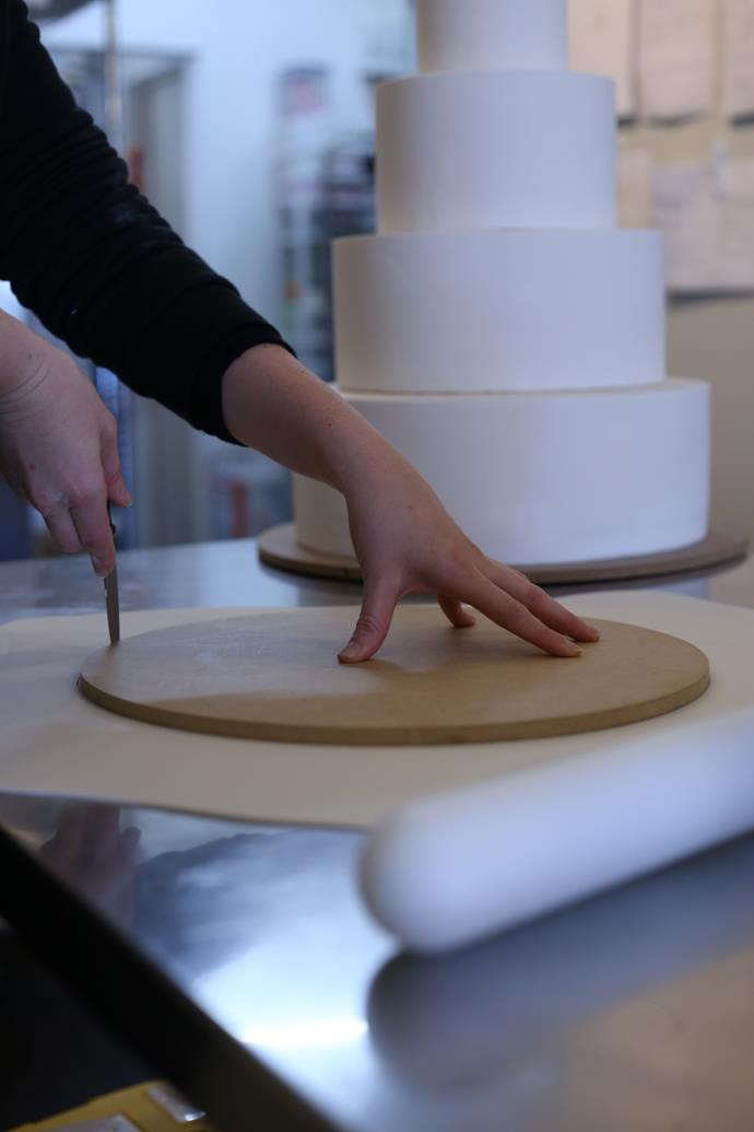 "**Step 5:** ""The base board is covered in fondant to match the cake."""