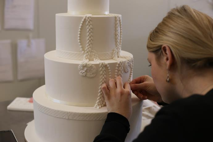 "**Step 7:** ""We begin by measuring and placing the first part of the lace onto the cake—in this step we create our outline for how we want the sugar lace to be viewed."""