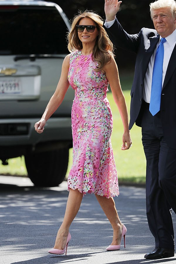Melania steps out wearing a vibrant Monique Lhuillier midi dress, complete with matching Christian Louboutin pumps.