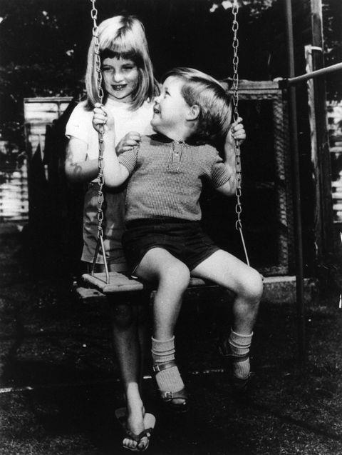 **1967**  Diana playing with her brother Charles Edward Maurice on the grounds of Park House, Sandringham when she was six years old.