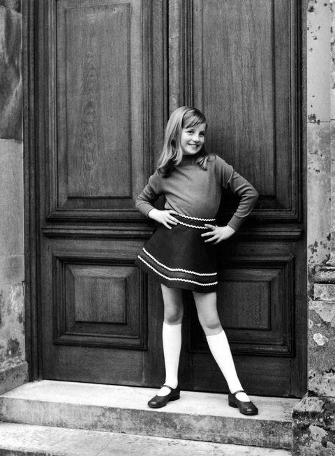**1967-69**  A photo from a private family album shows Diana posing cheekily as a young girl. Obviously a natural in front of the camera, she also had a keen sense of style from an early age.