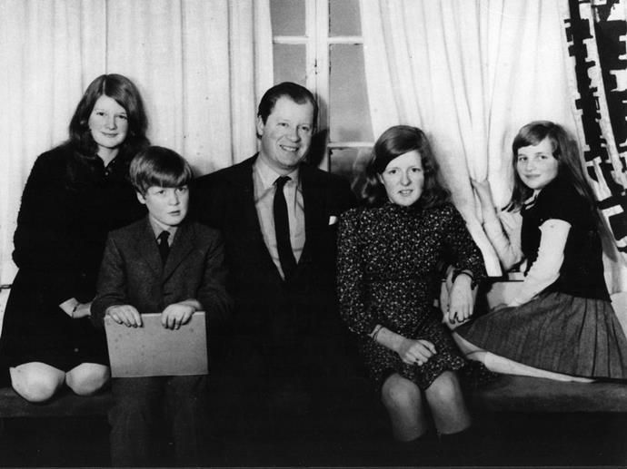 **1970**  Diana, her siblings, and her father pose for a photograph at home. The family moved to the Spencer estate after Diana's grandfather died, making her father the eighth Earl Spencer.