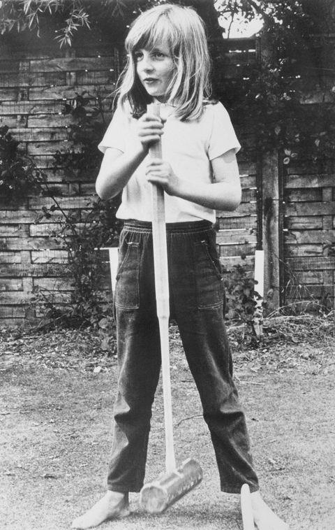 **1970**  A barefoot Diana poses with a croquet mallet while on holiday in Itchenor, West Sussex.
