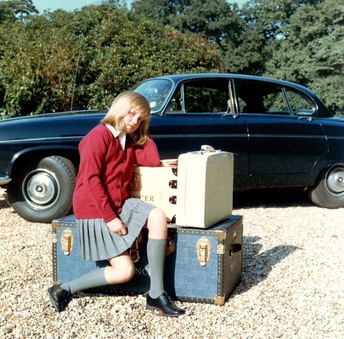 "**1970**  Diana sits on her suitcases as she prepares to go to boarding school at Riddlesworth Hall. Distraught over the separation from her home, she told her father, ""If you love me, you won't leave me here."""