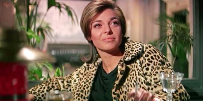 "**MRS. ROBINSON, *THE GRADUATE*** <br><br> She may be one of the most iconic seductresses in cinematic history, but Mrs. Robinson's wardrobe is just as legendary. With leopard coats, silky slips, and that sheer little black dress, Mrs. Robinson (played by Anne Bancroft), not only invented the term ""cougar,"" but also wrote the style book for it."