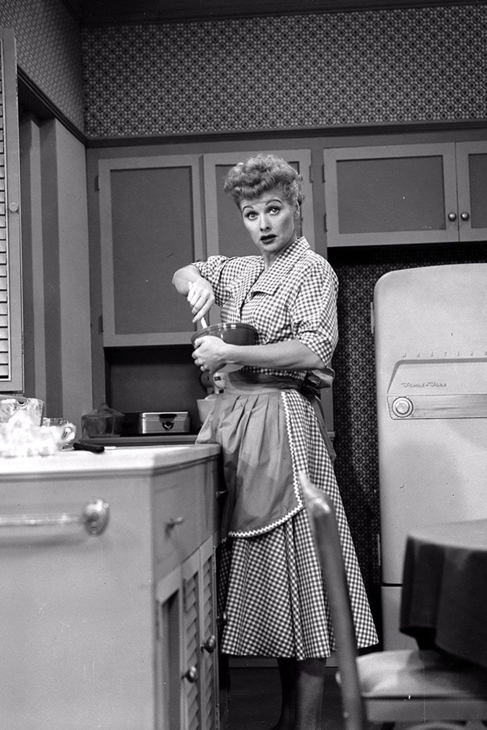 **LUCILLE BALL, *I LOVE LUCY*** <br><br> The style inspiration for every woman in the 1950s, Lucy's memorable looks included post-WWII printed frocks and fit-and-flare dresses resembling Dior's New Look.
