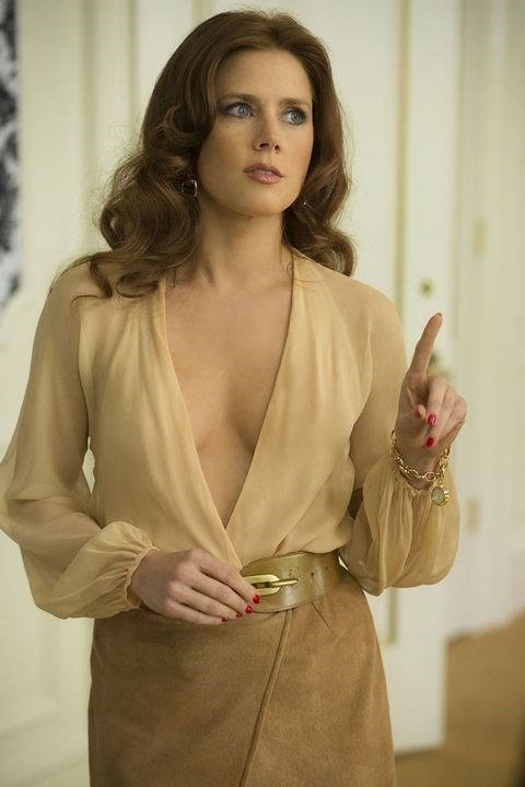 **SYDNEY PROSSER, *AMERICAN HUSTLE*** <br><br> Amy Adams' glamorous '70s wardrobe—plunging necklines, suede skirts, and wrap dresses—in *American Hustle* is enough to make any woman of the 2010s want to take their closet back a few decades.